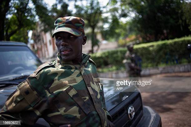 The head of the M23 rebel military forces BrigadierGeneral Sultani Makenga leans on a car on November 25 2012 on the grounds of a military residence...