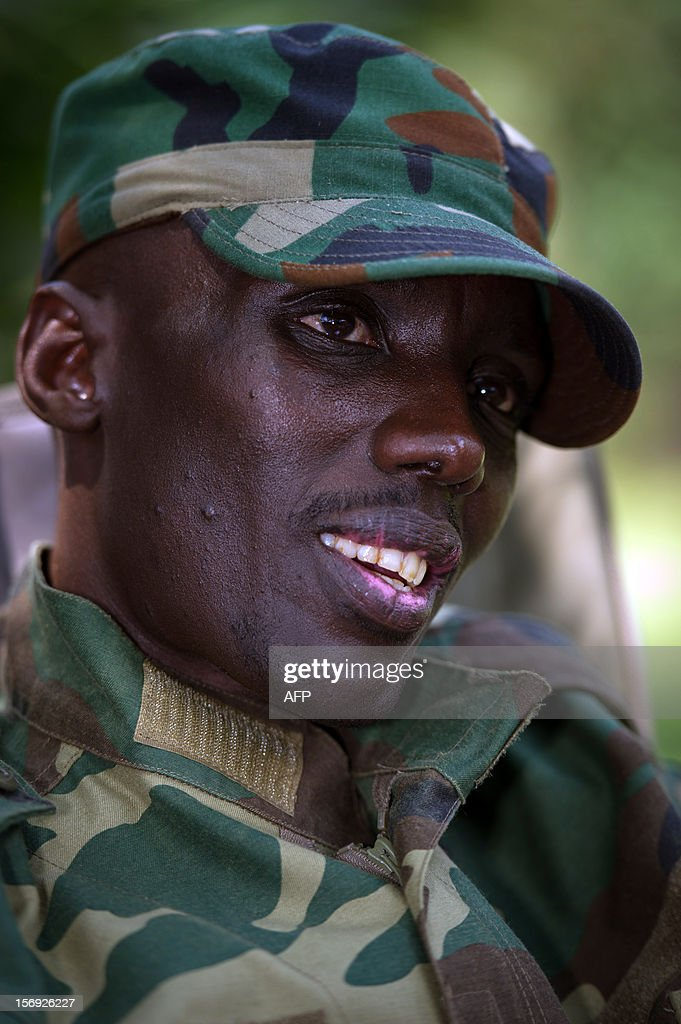 The head of the M23 rebel military forces, Brigadier-General Sultani Makenga, sits on November 25, 2012 at a military residence in Goma in the east of the Democratic Republic of the Congo. Over half a million people have been displaced in eastern Congo since the outbreak of the M23 rebellion. Diplomatic efforts continued on November 25 to resolve the crisis in eastern DR Congo, with an M23 rebel leader expected to hold further talks with President Joseph Kabila as the African Union called on the rebels to pull out from Goma.