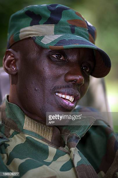 The head of the M23 rebel military forces BrigadierGeneral Sultani Makenga sits on November 25 2012 at a military residence in Goma in the east of...