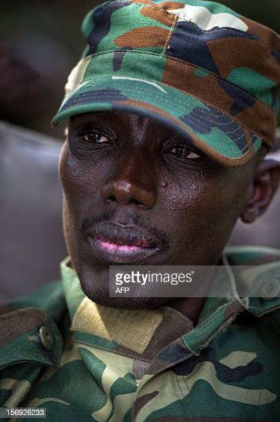 The head of the M23 rebel military forces BrigadierGeneral Sultani Makenga sits on November 25 2012 in the yard of a military residence in Goma in...