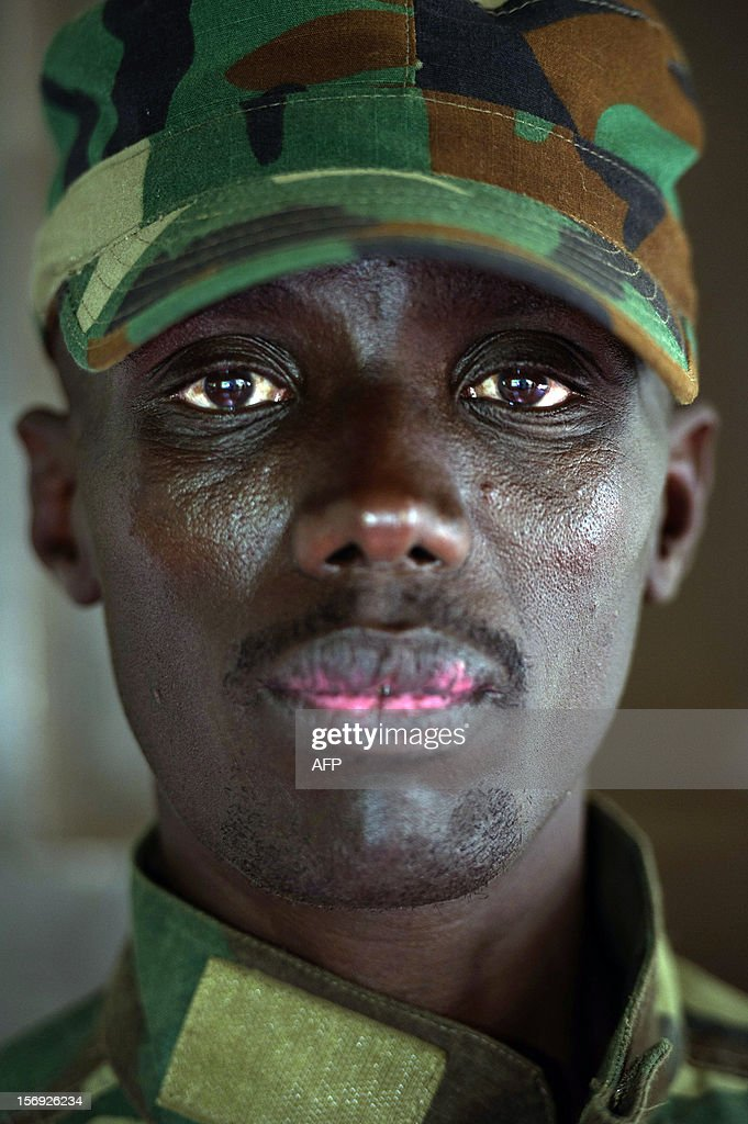 The head of the M23 rebel military forces, Brigadier-General Sultani Makenga, sits on November 25, 2012 in the yard of a military residence in Goma in the east of the Democratic Republic of the Congo. Over half a million people have been displaced in eastern Congo since the outbreak of the M23 rebellion. Diplomatic efforts continued on November 25 to resolve the crisis in eastern DR Congo, with an M23 rebel leader expected to hold further talks with President Joseph Kabila as the African Union called on the rebels to pull out from Goma. AFP PHOTO / PHIL MOORE