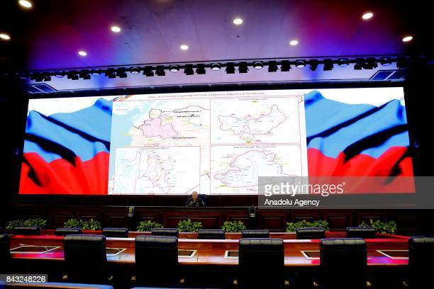 The head of the Main Operational Directorate of the Russian Armed Forces General Staff Lt Gen Sergei Rudskoi speaks to the media at the Ministry of...