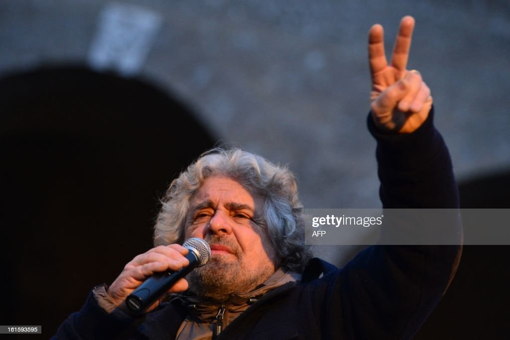 The head of the populist Five Star Movement, comedian Beppe Grillo, whose has been winning votes among those critical of Monti's austerity policy, addresses supporters during an electoral rally on February 12, 2013 in Bergamo, northern Italy. Comedian-turned-politician Beppe Grillo is candidate to the general elections on February 24-25.