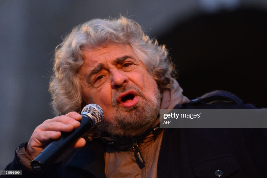 The head of the populist Five Star Movement, comedian Beppe Grillo, whose has been winning votes among those critical of Monti's austerity policy, addresses supporters during an electoral rally on February 12, 2013 in Bergamo, northern Italy. Comedian-turned-politician Beppe Grillo is candidate to the general elections on February 24-25. AFP PHOTO / GIUSEPPE CACACE