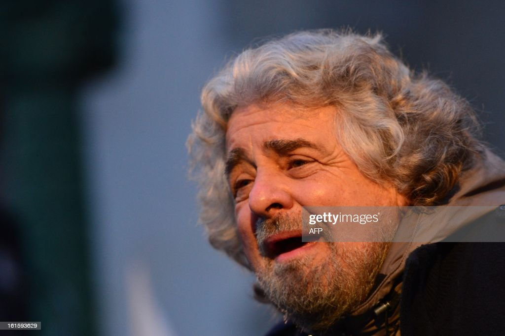The head of the populist Five Star Movement, comedian Beppe Grillo, whose has been winning votes among those critical of Monti's austerity policy, is seen on a screen as he addresses supporters during an electoral rally on February 12, 2013 in Bergamo, northern Italy. Comedian-turned-politician Beppe Grillo is candidate to the general elections on February 24-25.