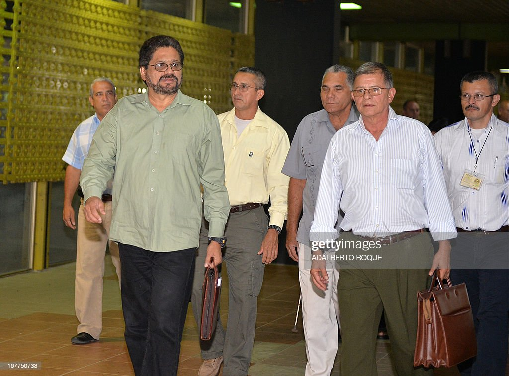 The head of the Revolutionary Armed Forces of Colombia (FARC) guerrilla delegation, commander Ivan Marquez (front, L) and commander Rodrigo Granda (front, R in front) arrive at the Conventions Palace in Havana for the peace talks with the Colombian Government, on April 29, 2013. Colombian peace talks designed to end Latin America's last and oldest insurgency resumed on April 23 after a month's recess. Since the negotiations began on November 19, only the first item on the agenda -- land reform -- has been addressed although the rebels have suggested some 100 other measures. AFP PHOTO/ADALBERTO ROQUE