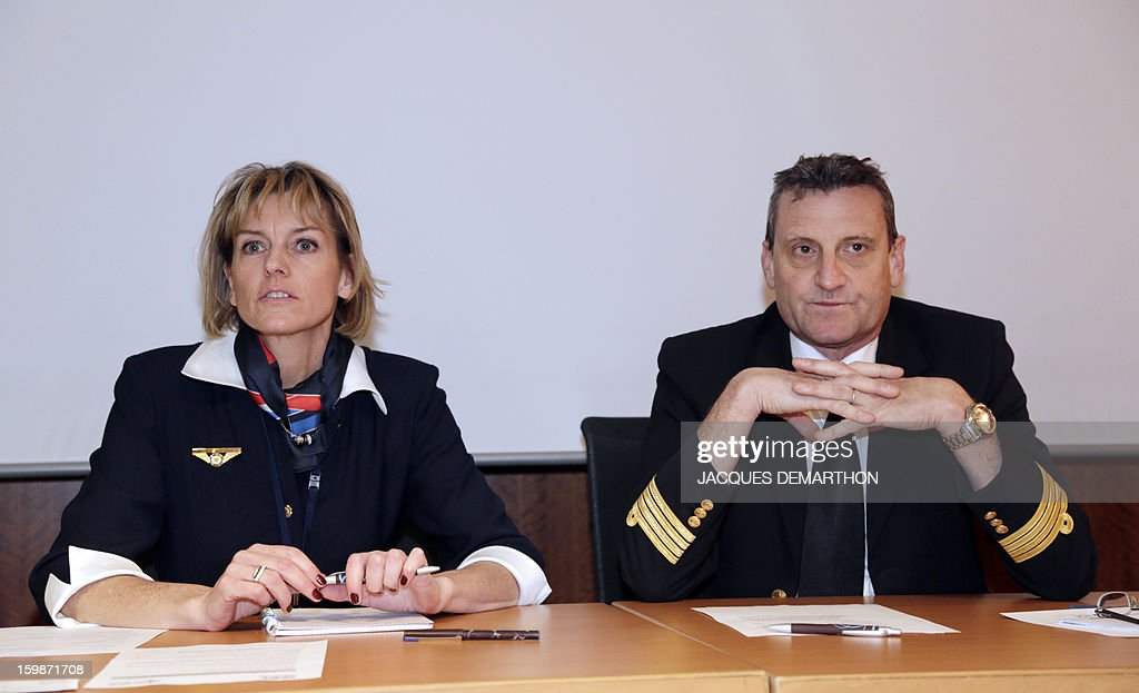 The head of the SNPL pilots' union, Yves Deshayes (R) and SNPL's deputy general secretary, Sophie Gorins (L) give a press conference on January 22, 2013 at Roissy Charles-de-Gaulle airport, in Roissy-en-France outside Paris, prior to a protest by pilots and cabin crew members at the airport's terminals, as part of a strike of European pilots. AFP PHOTO JACQUES DEMARTHON
