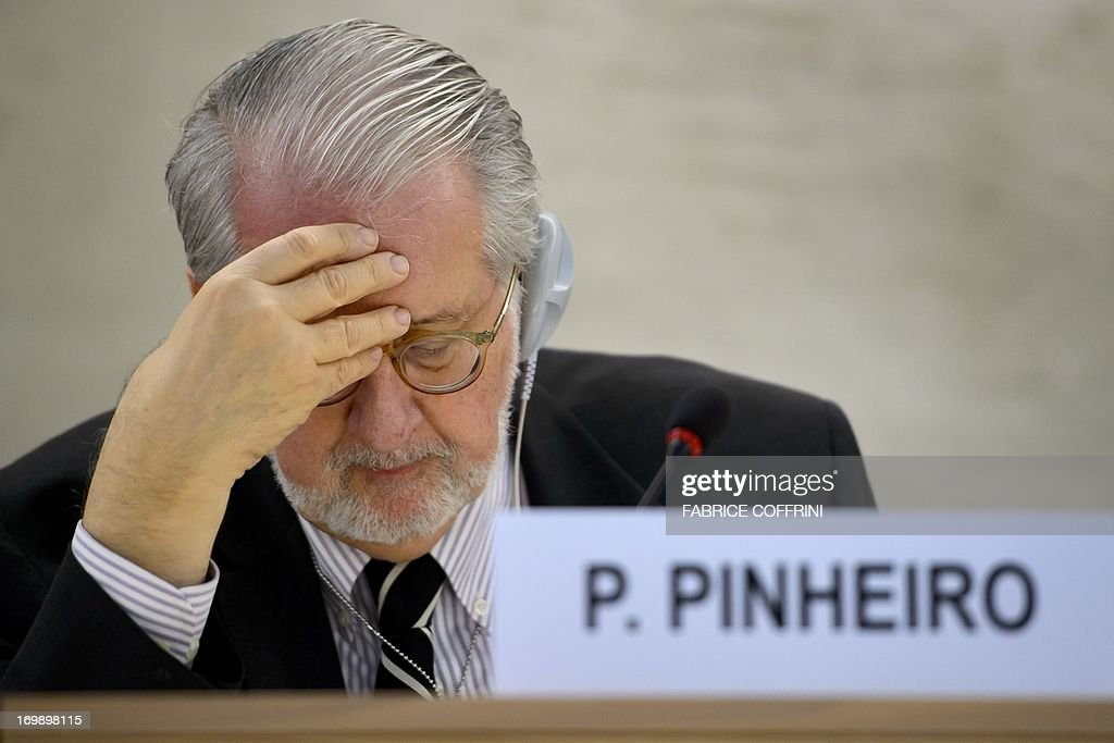 The head of the United Nations Independent Commission of Inquiry (CoI) on Syria, Brazilian Paulo Sergio Pinheiro, checks documents on June 4, 2013 before delivering a report to the UN Human Rights Council Geneva. UN investigators said on June 4 they had 'reasonable grounds' to believe chemical weapons have been used by both sides in Syria, and warned that crimes against humanity are now occurring daily in the war-torn country.