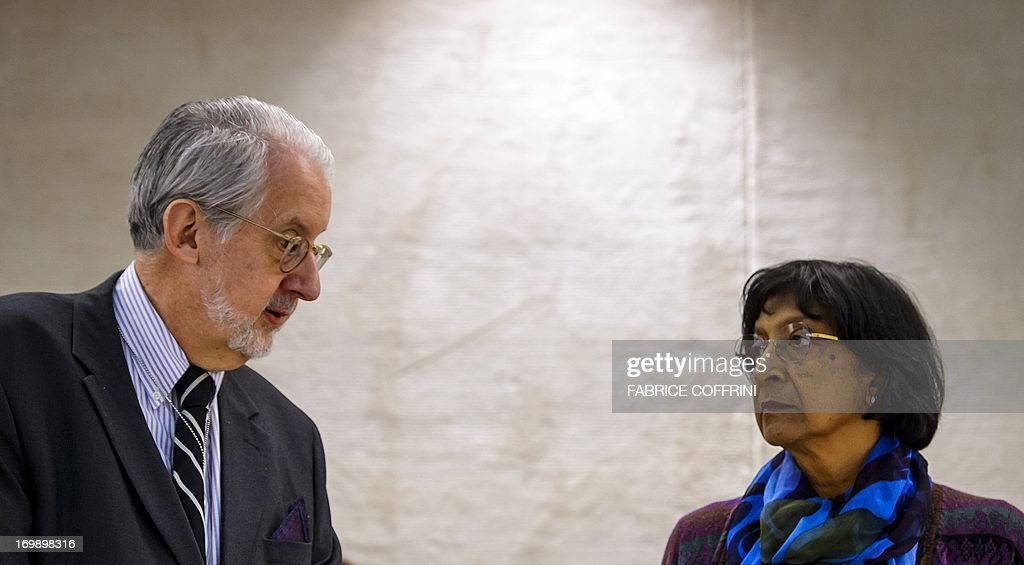 The head of the United Nations Independent Commission of Inquiry (CoI) on Syria, Brazilian Paulo Sergio Pinheiro (L) speaks with High Commissioner for Human Rights Navi Pillay on June 4, 2013 before delivering a report to the UN Human Rights Council in Geneva. UN investigators said on June 4 they had 'reasonable grounds' to believe chemical weapons have been used by both sides in Syria, and warned that crimes against humanity are now occurring daily in the war-torn country. AFP PHOTO / FABRICE COFFRINI