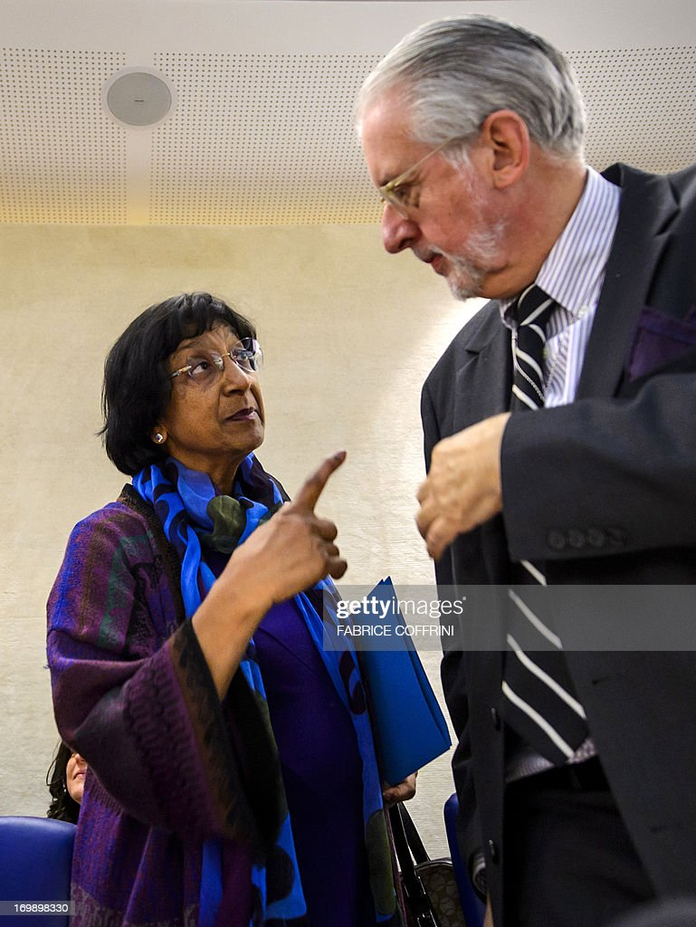 The head of the United Nations Independent Commission of Inquiry (CoI) on Syria, Brazilian Paulo Sergio Pinheiro (R) speaks with High Commissioner for Human Rights Navi Pillay on June 4, 2013 before delivering a report to the UN Human Rights Council in Geneva. UN investigators said on June 4 they had 'reasonable grounds' to believe chemical weapons have been used by both sides in Syria, and warned that crimes against humanity are now occurring daily in the war-torn country. AFP PHOTO / FABRICE COFFRINI