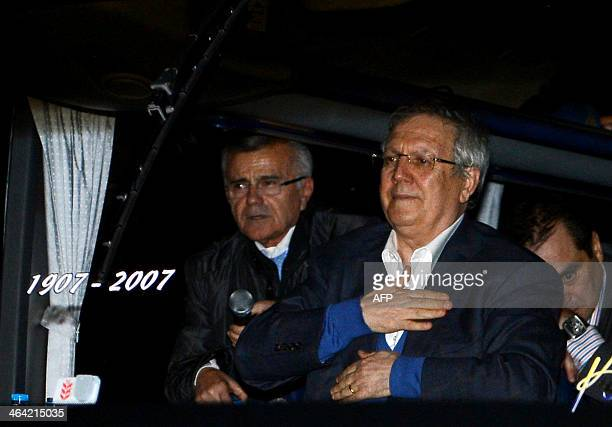 The head of Turkish football giant Fenerbahce Aziz Yildirim waves fans on January 21 2014 upon his arrival at Sabiha Gokcen Airport in Istanbul The...