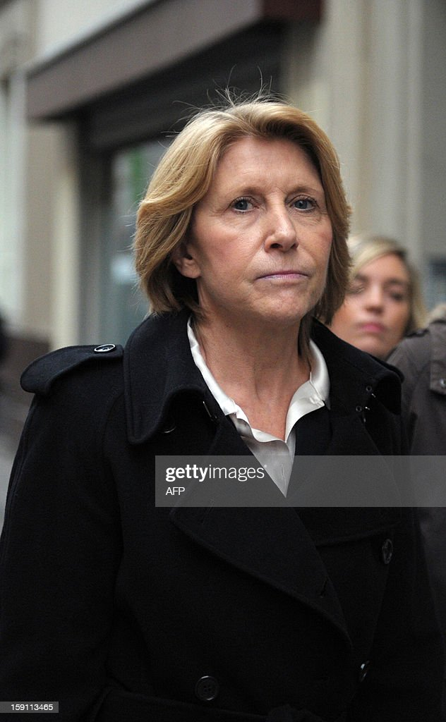 The head of Virgin Stores Christine Mondollot leaves after a meeting with members of Virgin Megastore's works council in Paris on January 8, 2013. Unions said Virgin Megastore will file for bankruptcy on January 9. Virgin France has closed several outlets and shed 200 employees in recent years. A new management team took over in mid-2012 in a bid to rework the company's strategy. AFP PHOTO / ERIC PIERMONT