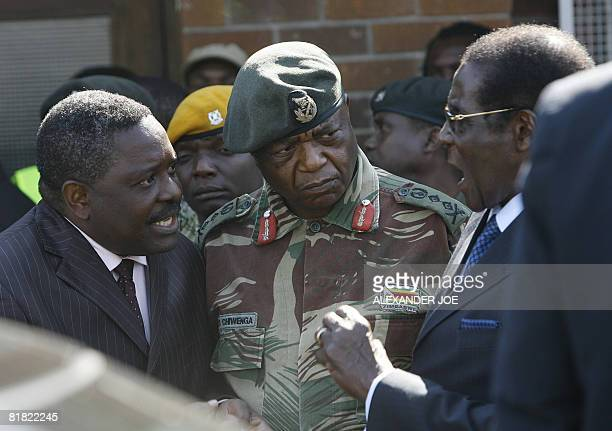 The head of Zimbabwe Central Intelligence Organisation Happyton Bonyongwe with Constantine Chiwenga the commander of the Zimbabwean Army are pictured...