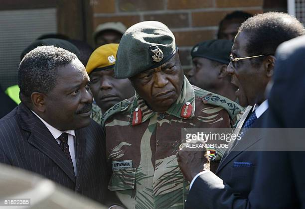 The head of Zimbabwe Central Intelligence Organisation Happyton Bonyongwe with Constantine Chiwenga the commander of the Zimbabwean Army listen to...
