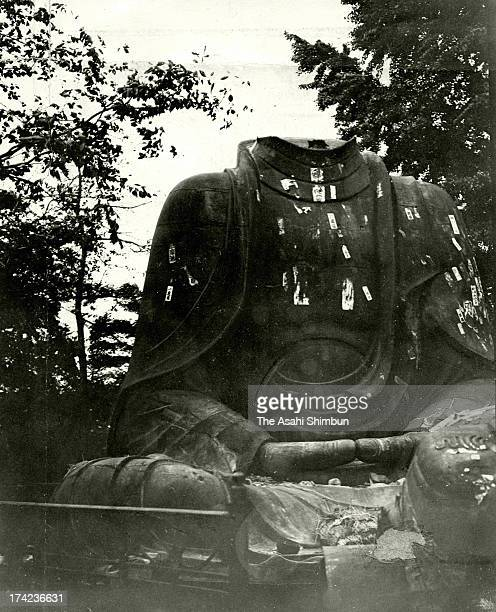 The head part of the Great Buddha statue is dropped by the Great Kando Earthquake at Ueno Park in September 1923 in Tokyo Japan The estimated...