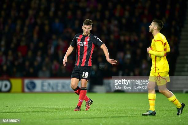 The headband of AFC Bournemouth's Baily Cargill slips off his head