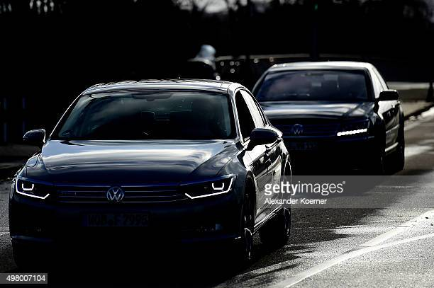 The headlights of a Volkswagen Passat and a Volkswagen Phaeton are seen at the main entrance gate of the Volkswagen group on November 20 2015 in...