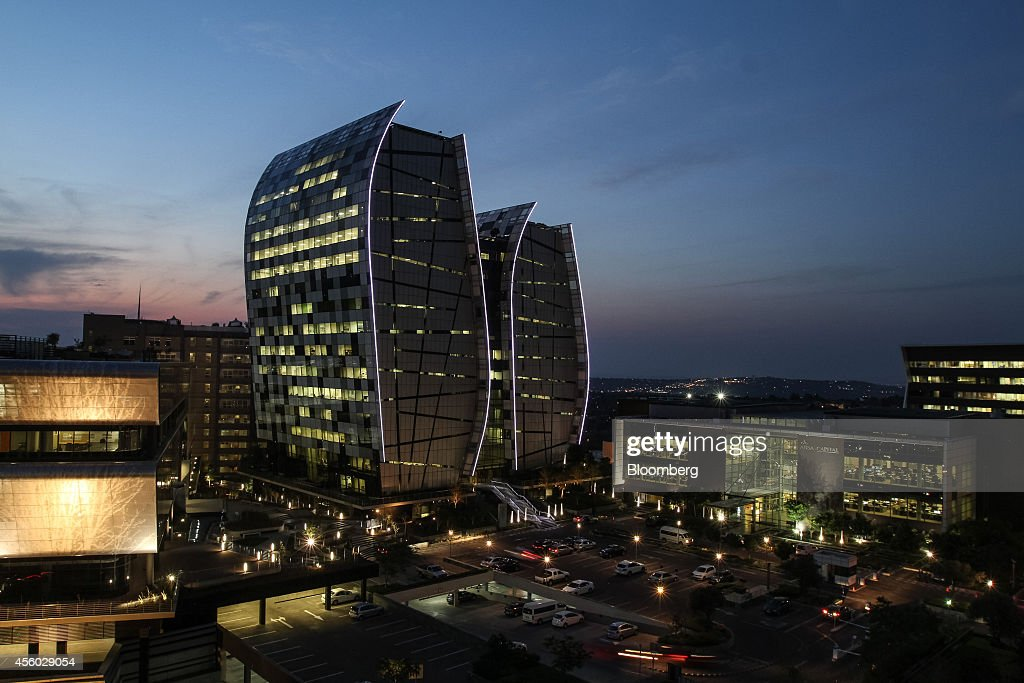 The headquarters of ABSA Capital Ltd a unit of Barclays Bank Plc sits illuminated at night in Sandton South Africa on Tuesday Sept 23 2014 Sandton...