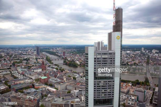 The headquarters of Commerzbank AG Germany's secondbiggest bank is seen standing above the rooftops of buildings in Frankfurt Germany on Wednesday...