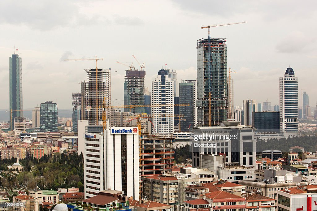 The headquarters of Denizbank AS, left, is seen beyond construction cranes and skyscrapers in the Levent-Maslak business districts of Istanbul, Turkey, on Thursday, April 4, 2013. Turkey's gross domestic product expanded 2.2 percent in 2012, down from 8.8 percent the previous year, according to data released by the statistics office in Ankara on April 1. Photographer: Kerem Uzel/Bloomberg via Getty Images