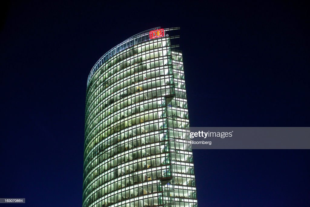 The headquarters of Deutsche Bahn AG stand illuminated in Berlin, Germany, on Sunday, March 3, 2013. Germany's 10-year government bonds advanced for a second day even before a report that economists said will show producer prices in the euro area increased for the first time in four months in January. Photographer: Krisztian Bocsi/Bloomberg via Getty Images
