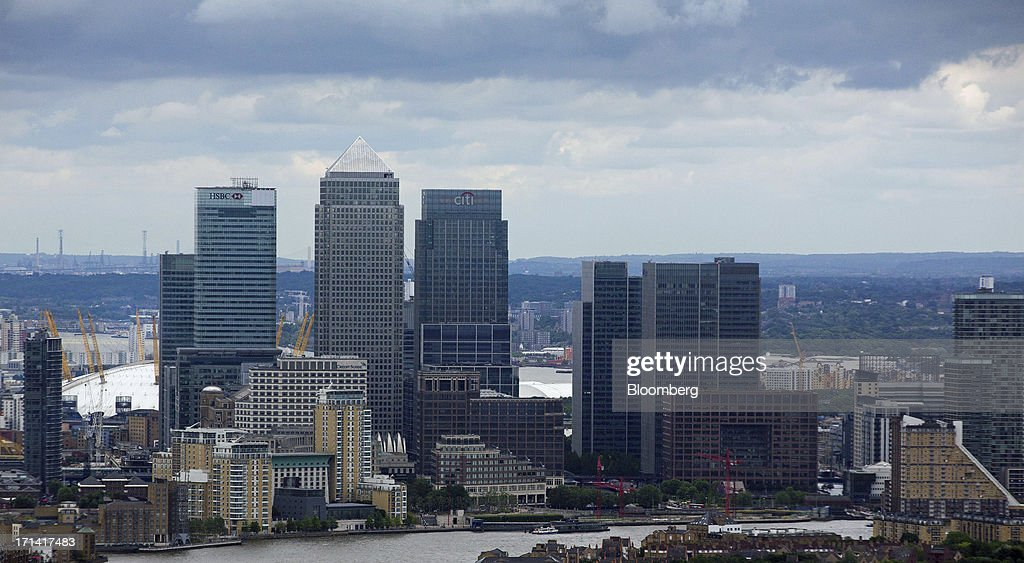 The headquarters of HSBC Holdings Plc, left, No. 1 Canada Square, or Canary Wharf Tower, center, and Citigroup Inc.'s offices, are seen from the Swiss Re building, also known as the 'Gherkin', in London, U.K., on Sunday, June 23, 2013. U.K. commercial real estate values rose for the first time in 18 months in May, led by increasing demand for offices, Investment Property Databank Ltd. said. Photographer: Jason Alden/Bloomberg via Getty Images