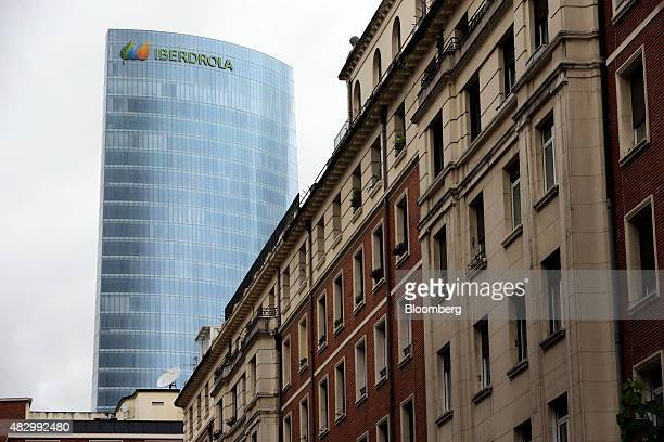 The headquarters of Iberdrola SA stands beyond residential property in Bilbao Spain on Tuesday Aug 4 2015 Iberdrola SA Spain's largest utility agreed...