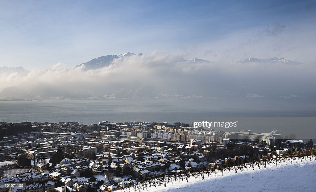 The headquarters of Nestle SA, right, stand on the skyline in Vevey, Switzerland, on Thursday, Feb. 14, 2013. Nestle SA said it expects 2013 to be as challenging as last year, when sales missed analysts' estimates on a slowdown in emerging markets, a region the world's largest food company is increasingly dependent upon. Photographer: Valentin Flauraud/Bloomberg via Getty Images