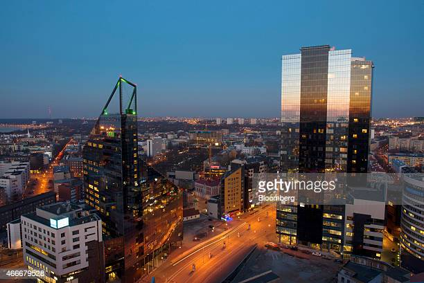 The headquarters of SEB Pank AS left stands on the city skyline at dusk in Tallinn Estonia on Tuesday March 17 2015 Estonia has been one of Europe's...