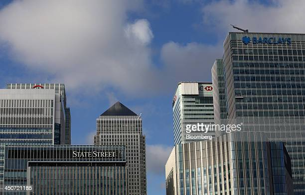 The headquarters of State Street Corp left HSBC Holdings Plc second right and Barclays Plc right stand amongst skyscrapers in the Canary Wharf...