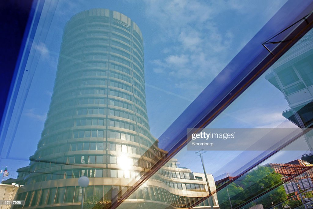 The headquarters of the Bank for International Settlements (BIS) in are reflected in a window in Basel, Switzerland, on Tuesday, June 25, 2013. Central banks can't expand loose monetary policy without exacerbating risks to world economies, the Bank for International Settlements said this week. Photographer: Gianluca Colla/Bloomberg via Getty Images