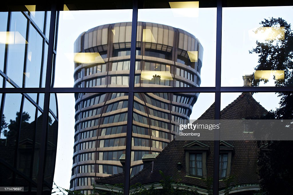 The headquarters of the Bank for International Settlements (BIS) is reflected in the window of a building in Basel, Switzerland, on Tuesday, June 25, 2013. Central banks can't expand loose monetary policy without exacerbating risks to world economies, the Bank for International Settlements said this week. Photographer: Gianluca Colla/Bloomberg via Getty Images