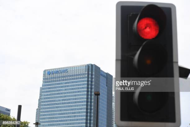The headquarters of the British bank Barclays is seen at the Canary Wharf district of east London on June 20 2017 with a traffic light in the...
