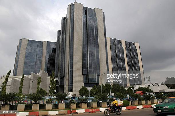 The headquarters of the Nigerian central bank stands in Abuja Nigeria on Wednesday Oct 21 2015 A drop in crude prices in the past year has put...