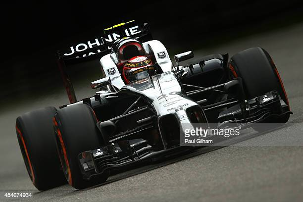 The headrest belonging to Kevin Magnussen of Denmark and McLaren comes loose during Practice ahead of the F1 Grand Prix of Italy at Autodromo di...