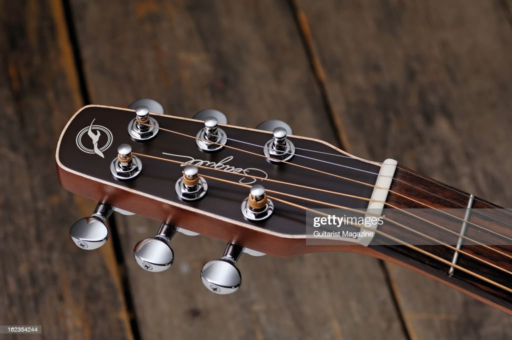 The headstock of a Seagull Entourage Grand Rustic acoustic guitar photographed during a studio shoot for Guitarist Magazine, July 25, 2012.