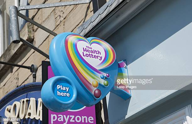 The Health Lottery sign on a shop