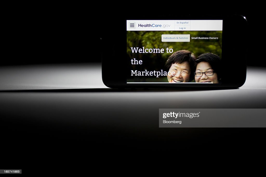 The Healthcare.gov website is displayed on an Apple Inc. iPhone arranged for a photograph in Washington, D.C., U.S., on Thursday, Oct. 24, 2013. The failure of Obamacare's website to process millions of applications drew fire from contractors who said more time was needed for final testing and from lawmakers who traded criticism over political motivations. Photographer: Andrew Harrer/Bloomberg via Getty Images