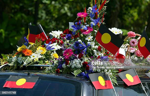 The hearse adorned with flowers and Aboriginal flags during the funeral of Cameron Doomadgee who died in police custody on Palm Island Queensland 11...