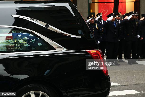 The hearse carrying Joseph Lemm makes its way along Fifth Avenue after departing St Patrick's Cathedral on December 30 2015 in New York City...