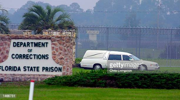 The hearse carrying the body of convicted killer Aileen Wuornos leaves the Florida State Prison following her execution by lethal injection October 9...