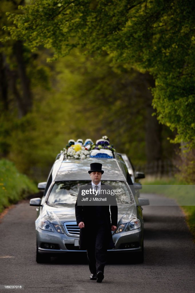 The hearse carrying the coffin of Corporal William Savage from The Royal Highland Fusiliers, 2nd Battalion The Royal Regiment Of Scotland makes its way to Glencorse Kirk on May 22, 2013 in Penicuik, Scotland. Corporal Savage was killed along with Fusilier Samuel Flint and Pte Robert Hetherington when their Mastiff vehicle was hit by an improvised explosive device while on patrol in Helmand province in Afghanistan on April 30.