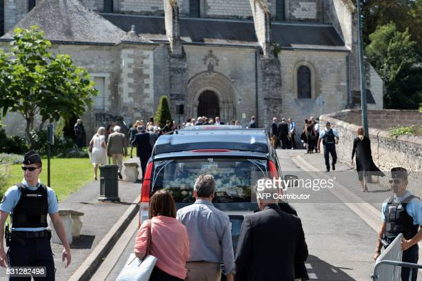 The hearse carrying the coffin of late French writer and journalist Gonzague Saint Bris arrives for the funeral ceremony at the Collegiate Church of...