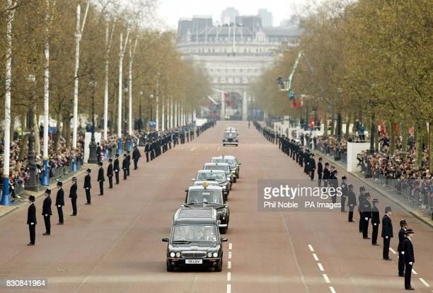 The hearse carrying the coffin of Queen Elizabeth the Queen Mother drives down The Mall in London as it travels to to St George's Chapel in Windsor...