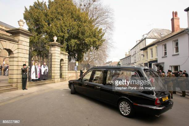 The hearse carrying the coffin of Rifleman Jamie Gunn arrives at St Mary's Church in Monmouth for the funeral service Rifleman Jamie Gunn was with...