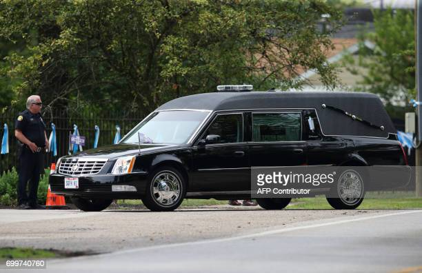 The hearse carrying the remains of Otto Warmbier enters Oak Hill Cemetery in Cincinnati Ohio following the funeral in Wyoming Ohio on June 22 for...