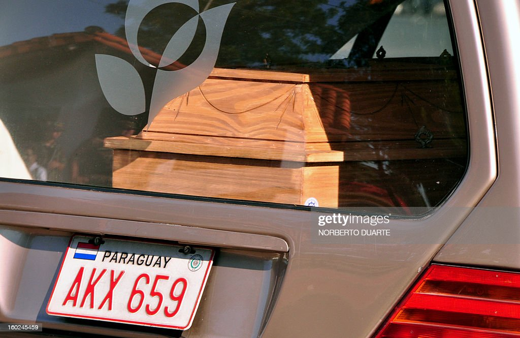 The hearse carrying the remains of Paraguayan student Guido Britez, 21, who died on a fire accident in a nightclub in Brazil, heads to Asuncion -from an Air Force Base in Luque- on January 28, 2013. On the eve, a blaze in a nightclub in Santa Maria, southern Brazil, left 231 people dead and at least 100 others remained hospitalized, 80 of them in serious condition.