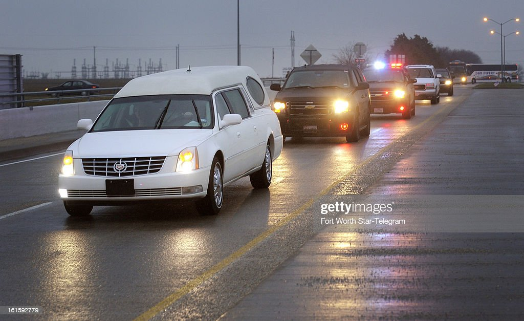 The hearse containing Chris Kyle's casket leaves the Multi-Purpose Stadium in Midlothian, Texas, Tuesday, February 12, 2013.