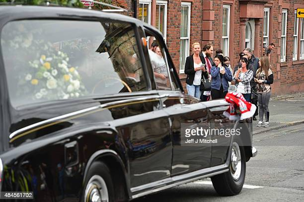 The hearse containing the coffin of Cilla Black leaves B Jenkins and Son on Church Road North as it makes its way to St Mary's RC Church in Woolton...