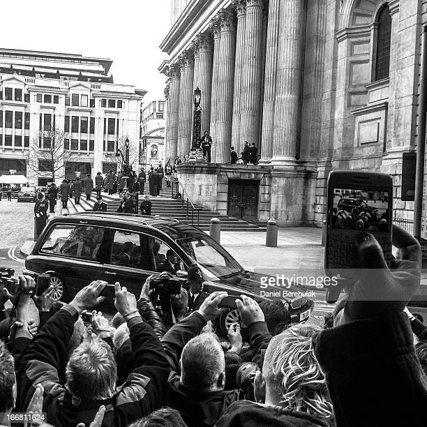 The hearse departs after the ceremonial funeral of former British Prime Minister Baroness Thatcher at St Paul's Cathedral as people gather to pay...